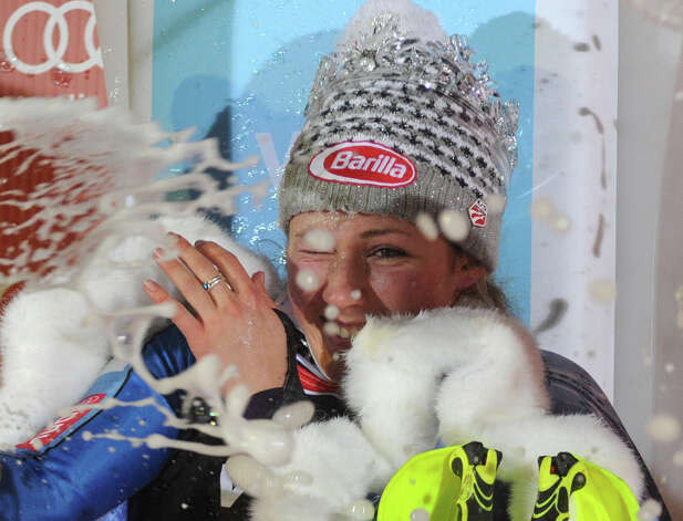 Mikaela Shiffrin, of the United States, celebrates with champagne on the podium after winning an alpine ski, women's World Cup slalom, in Zagreb, Croatia, Friday, Jan. 4, 2013. (AP Photo/Giovanni Auletta) Photo: Giovanni Auletta / AP