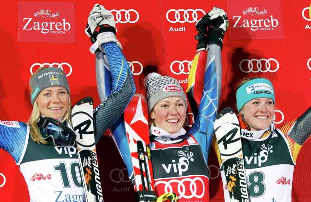 Mikaela Shiffrin from the U.S. center, Sweden's Maria Pietilae-Holmner, left and Canada's Erin Mielzynski celebrate on the podium after an alpine ski, women's World Cup slalom, in Zagreb, Croatia, Friday, Jan. 4, 2013. Shiffrin won the race, Pietilae-Holmner was second and Mielzynski third. (AP Photo/Darko Bandic) Photo: Darko Bandic / AP