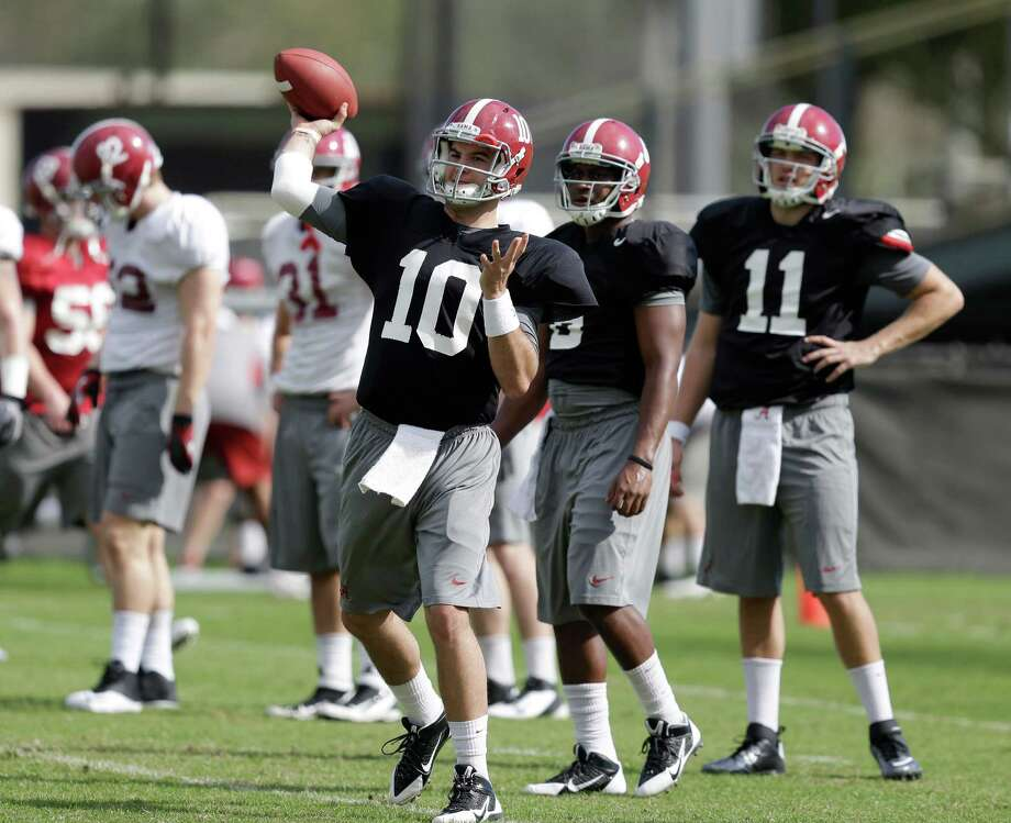 Alabama quarterback AJ McCarron (10) throws a pass during practice, Friday, Jan. 4, 2013, in Miami Shores, Fla. Alabama is scheduled to play Notre Dame on Monday, Jan. 7, in the BCS national championship NCAA college football game. (AP Photo/Wilfredo Lee) Photo: Wilfredo Lee