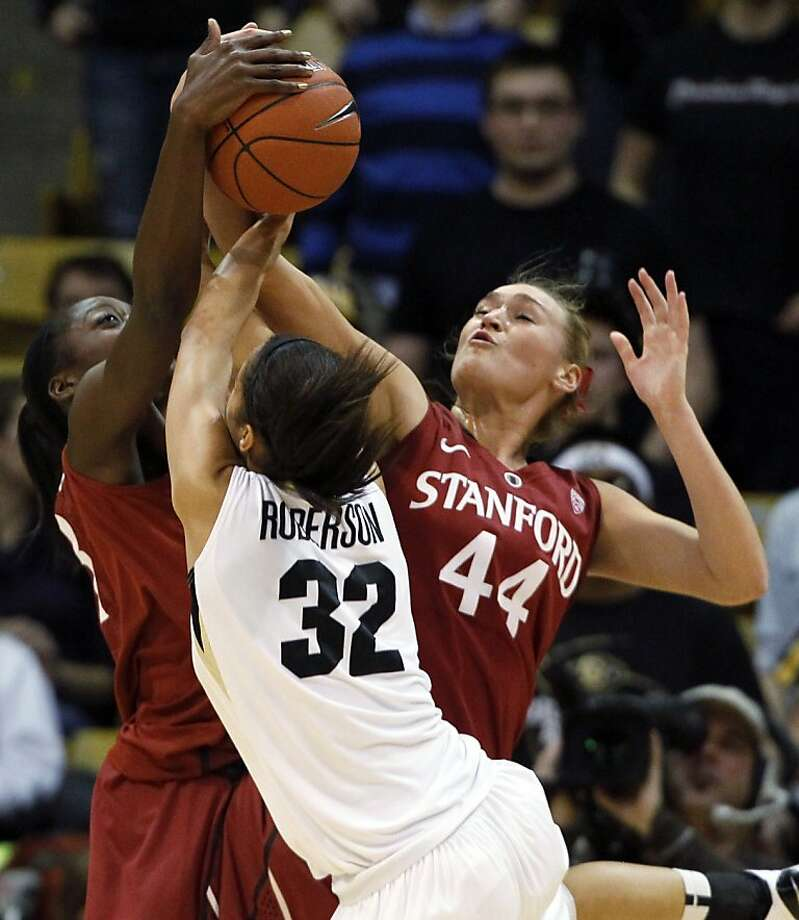 Stanford's Amber Orrange (left) and Joslyn Tinkle team up to block a shot by Colorado's Arielle Roberson. Photo: David Zalubowski, Associated Press