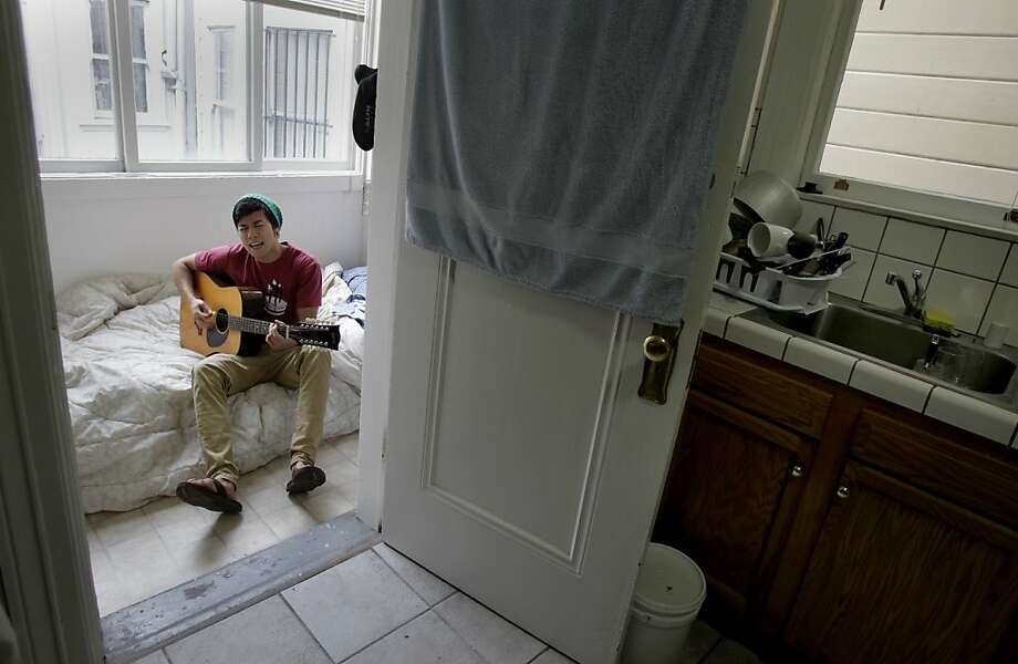 Dan Stifler pays $500 a month for a 7-by-5-foot laundry room off the kitchen in a Mission District flat. Photo: Brant Ward, The Chronicle