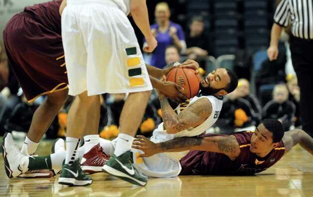 Rakeem Brookins (12), center, fights for a loose ball during their basketball game against Iona on Friday, Jan. 4, 2013, at Times Union Center in Albany, N.Y. (Cindy Schultz / Times Union) Photo: Cindy Schultz / 00020599B