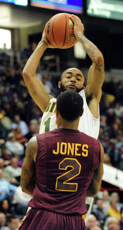 Rakeem Brookins (12), center, shoots for the hoop as Iona's Lamont Jones (2) defends during their basketball game on Friday, Jan. 4, 2013, at Times Union Center in Albany, N.Y. (Cindy Schultz / Times Union) Photo: Cindy Schultz / 00020599B