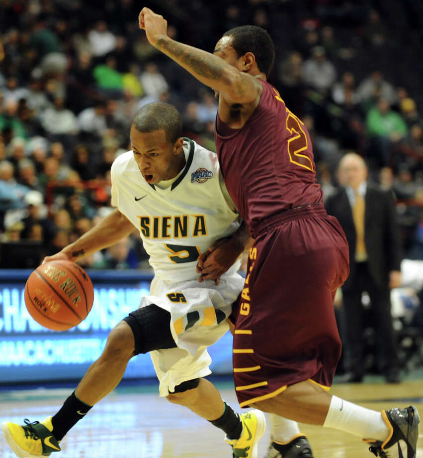 Siena's Evan Hymes (5), center, drives past Iona's Lamont Jones (2) during their basketball game on Friday, Jan. 4, 2013, at Times Union Center in Albany, N.Y. (Cindy Schultz / Times Union) Photo: Cindy Schultz / 00020599B