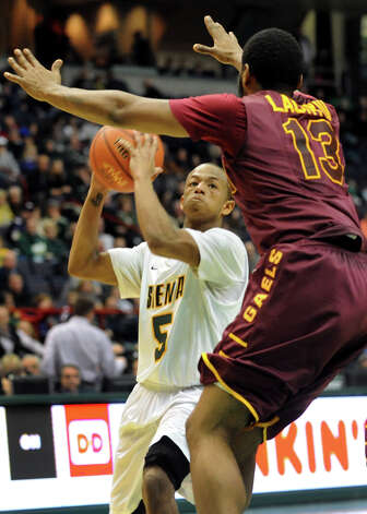 Siena's Evan Hymes (5), center, tries to get past Iona's David Laury (13) during their basketball game on Friday, Jan. 4, 2013, at Times Union Center in Albany, N.Y. (Cindy Schultz / Times Union) Photo: Cindy Schultz / 00020599B