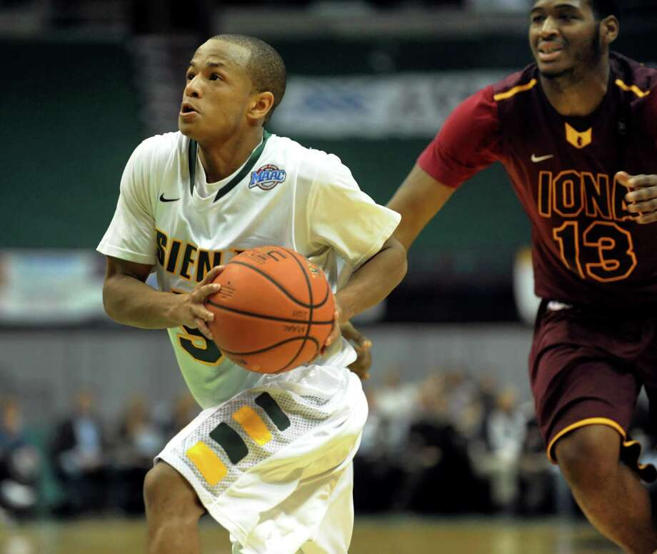 Siena's Evan Hymes (5), right, looks to the hoop as Iona's David Laury (13) defends during their basketball game on Friday, Jan. 4, 2013, at Times Union Center in Albany, N.Y. (Cindy Schultz / Times Union) Photo: Cindy Schultz / 00020599B