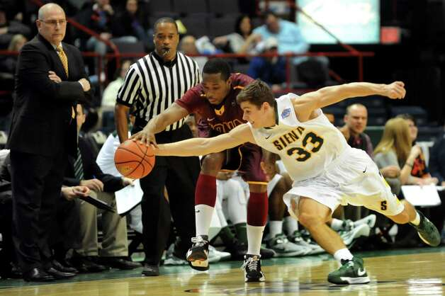 Siena's Rob Poole (33), right, struggles for a loose ball against Iona's Taaj Ridley (0) during their basketball game on Friday, Jan. 4, 2013, at Times Union Center in Albany, N.Y. (Cindy Schultz / Times Union) Photo: Cindy Schultz / 00020599B