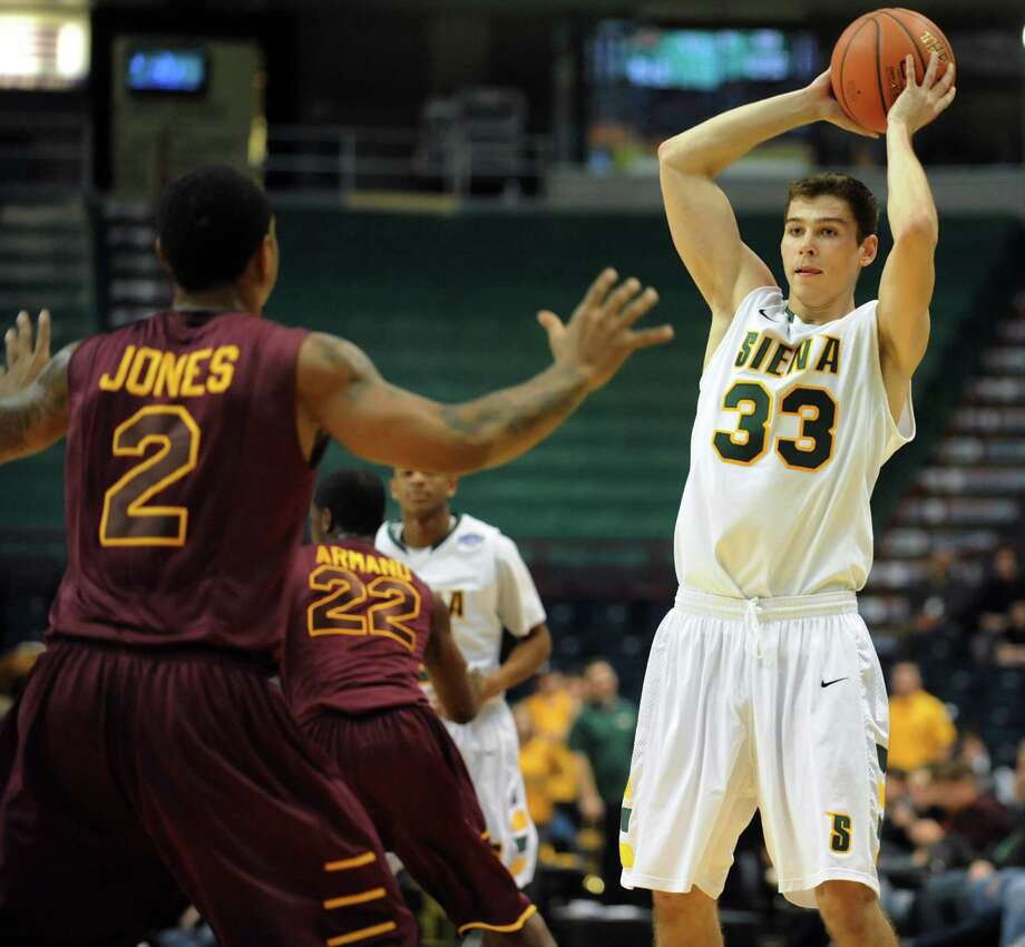 Siena's Rob Poole (33), right, looks to pass as Iona's Lamont Jones (2) defends during their basketball game on Friday, Jan. 4, 2013, at Times Union Center in Albany, N.Y. (Cindy Schultz / Times Union) Photo: Cindy Schultz / 00020599B