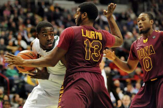 Siena's O.D. Anosike (1), left, works the paint as Iona's David Laury (13), center, and Taaj Ridley (0) defend during their basketball game on Friday, Jan. 4, 2013, at Times Union Center in Albany, N.Y. (Cindy Schultz / Times Union) Photo: Cindy Schultz / 00020599B