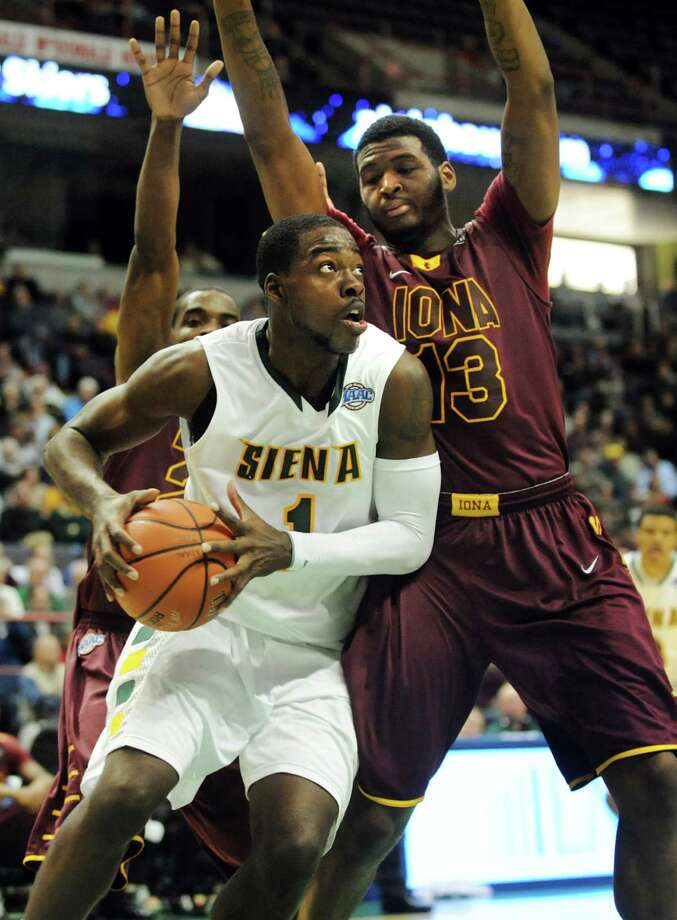 Siena's O.D. Anosike (1), left, looks to shoot as Iona's David Laury (13) defends during their basketball game on Friday, Jan. 4, 2013, at Times Union Center in Albany, N.Y. (Cindy Schultz / Times Union) Photo: Cindy Schultz / 00020599B