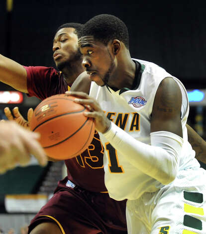 Siena's O.D. Anosike (1), right, drives to the hoop as Iona's David Laury (13) defends during their basketball game on Friday, Jan. 4, 2013, at Times Union Center in Albany, N.Y. (Cindy Schultz / Times Union) Photo: Cindy Schultz / 00020599B