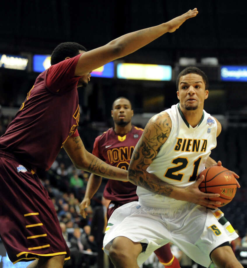 Siena's David Martens (21), right, drives to the hoop as Iona's David Laury (13) defends during their basketball game on Friday, Jan. 4, 2013, at Times Union Center in Albany, N.Y. (Cindy Schultz / Times Union) Photo: Cindy Schultz / 00020599B