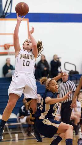 Lauralton Hall guard Carly Fabbri goes over Notre Dame-Fairfield's Briana Mann for a basket in a high school girls basketball game played at Lauralton Hall, Milford CT on Friday January 4th, 2013. Photo: Mark Conrad / Connecticut Post Freelance