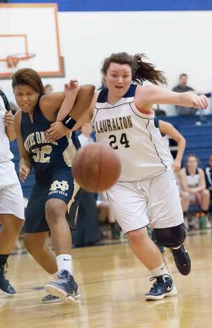 Notre Dame-Fairfield's Nakia Mabin and Lauralton Hall's Emily Bonzagni in a high school girls basketball game played at Lauralton Hall, Milford CT on Friday January 4th, 2013. Photo: Mark Conrad / Connecticut Post Freelance