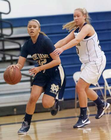 Notre Dame-Fairfield forward Briana Mann drives past Lauralton Hall's Bianca Robertson in a high school girls basketball game played at Lauralton Hall, Milford CT on Friday January 4th, 2013. Photo: Mark Conrad / Connecticut Post Freelance