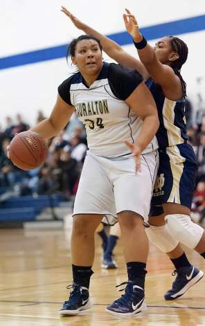 Lauralton Hall forward Olivia Levey runs into Notre Dame-Fairfield's Tekarah Coward on her way to the basket in a high school girls basketball game played at Lauralton Hall, Milford CT on Friday January 4th, 2013. Photo: Mark Conrad / Connecticut Post Freelance