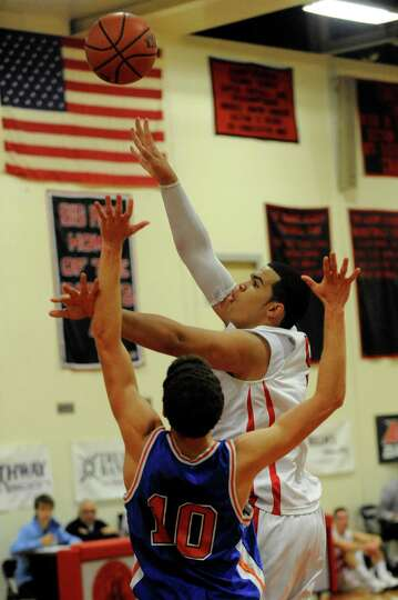 Collegiate School's Elias Bresnick (10) defends against Albany Academy's Marcus Jackson during their