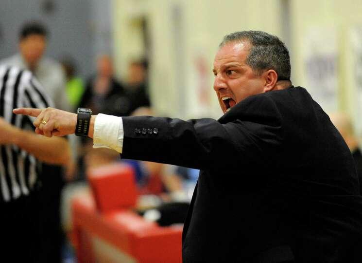 Albany Academy's head coach Brian Fruscio coaches his team against Collegiate School during their Hi