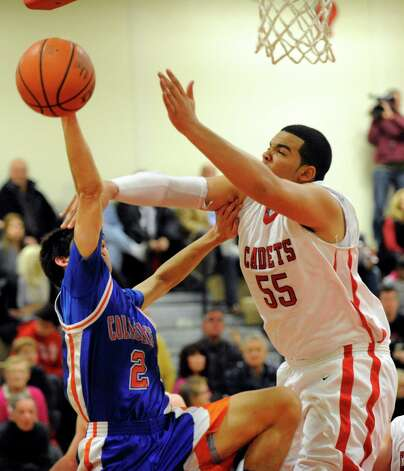 Albany Academy's Marcus Jackson (55) defends against Collegiate School's Emory Witt (2) during their High School Basketball game in Albany, N.Y., Friday, Jan. 4, 2013. (Hans Pennink / Special to the Times Union) High School Sports Photo: Hans Pennink / Hans Pennink