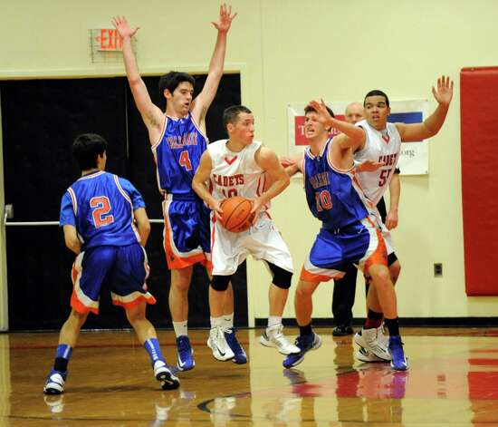 Albany Academy's John Moutopoulos (10) grabs a rebound against Collegiate School during their High School Basketball game in Albany, N.Y., Friday, Jan. 4, 2013. (Hans Pennink / Special to the Times Union) High School Sports Photo: Hans Pennink / Hans Pennink