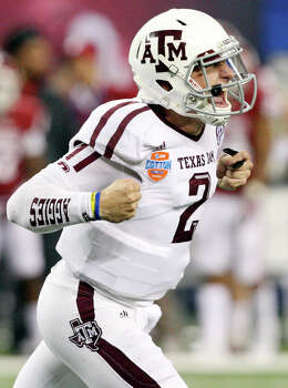 Texas A&M Aggies' Johnny Manziel reacts after a touchdown against the Oklahoma Sooners during second half action of the 77th AT&T Cotton Bowl Classic held Friday Jan. 4, 2013 at Cowboys Stadium in Arlington, Tx. Photo: Edward A. Ornelas, Express-News / © 2012 San Antonio Express-News