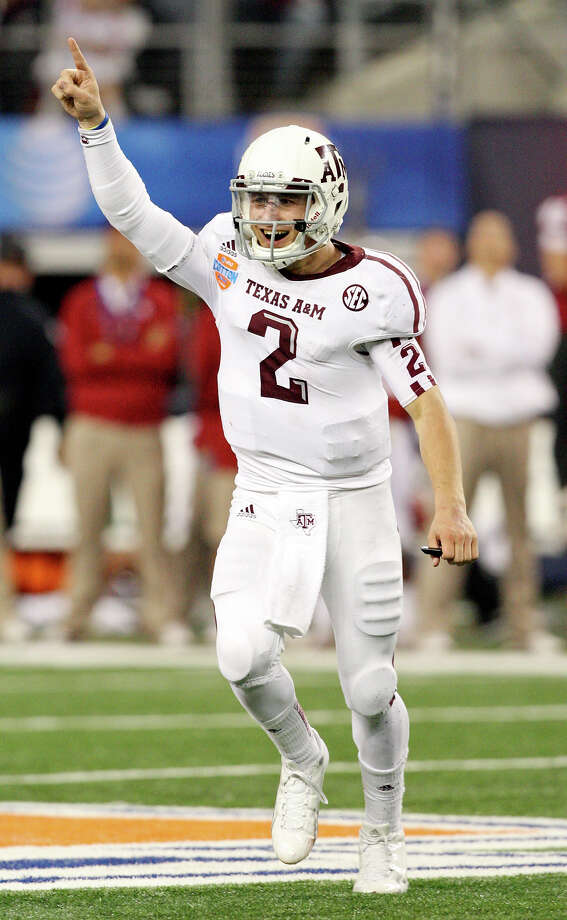 Texas A&M Aggies' Johnny Manziel reacts after a touchdown pass against the Oklahoma Sooners during second half action of the 77th AT&T Cotton Bowl Classic held Friday Jan. 4, 2013 at Cowboys Stadium in Arlington, Tx. Photo: Edward A. Ornelas, Express-News / © 2012 San Antonio Express-News