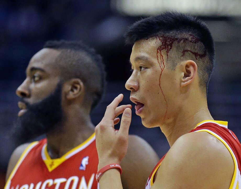 Jan. 4: Rockets 115, Bucks 101Jeremy Lin, right, reacts after colliding with Larry Sanders. Photo: Jeffrey Phelps, Associated Press / FR59249 AP