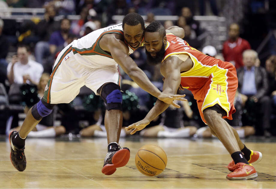 Luc Richard Mbah a Moute, left, and Rockets' James Harden reach for a loose ball. Photo: Jeffrey Phelps, Associated Press / FR59249 AP