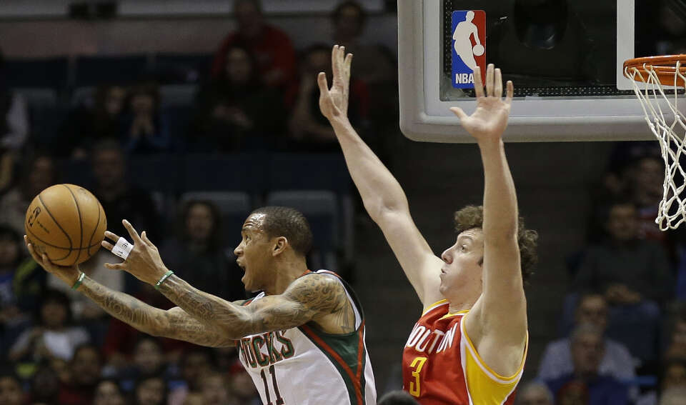 Monta Ellis, left, puts up a no-look shot against the Rockets' Omer Asik.