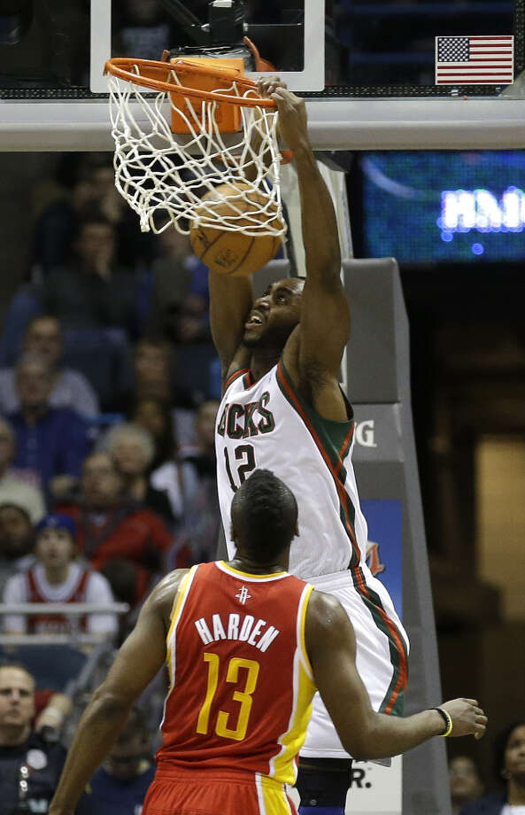 Luc Richard Mbah a Moute (12) dunks as James Harden (13) defends. Photo: JEFFREY PHELPS, Associated Press / FR59249 AP