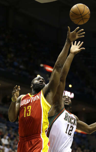 James Harden (13) shoots against the Bucks' Luc Richard Mbah a Moute.