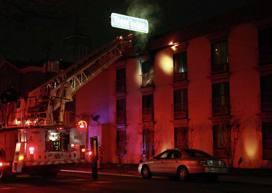The San Antonio Fire Department responds to a fire at the Travelodge Hotel at 405 Broadway St. in San Antonio Texas on Friday, January 4, 2013. Photo: Kevin Martin, Express-News / © 2012 San Antonio Express-News