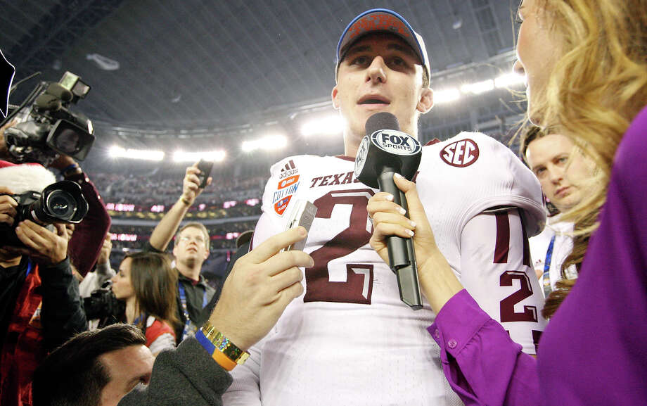 Texas A&M Aggies' Johnny Manziel answers questions from the media after the 77th AT&T Cotton Bowl Classic against the Oklahoma Sooners held Friday Jan. 4, 2013 at Cowboys Stadium in Arlington, Tx. The Aggies won 41-13. Photo: Edward A. Ornelas, Express-News / © 2012 San Antonio Express-News