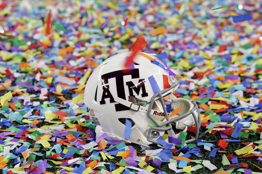 A Texas A&M Aggies helmet in confetti after the 77th AT&T Cotton Bowl Classic against the Oklahoma Sooners held Friday Jan. 4, 2013 at Cowboys Stadium in Arlington, Tx. The Aggies won 41-13. Photo: Edward A. Ornelas, Express-News / © 2012 San Antonio Express-News