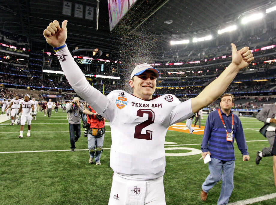 Texas A&M Aggies' Johnny Manziel celebrates after the 77th AT&T Cotton Bowl Classic against the Oklahoma Sooners held Friday Jan. 4, 2013 at Cowboys Stadium in Arlington, Tx. The Aggies won 41-13. Photo: Edward A. Ornelas, Express-News / © 2012 San Antonio Express-News