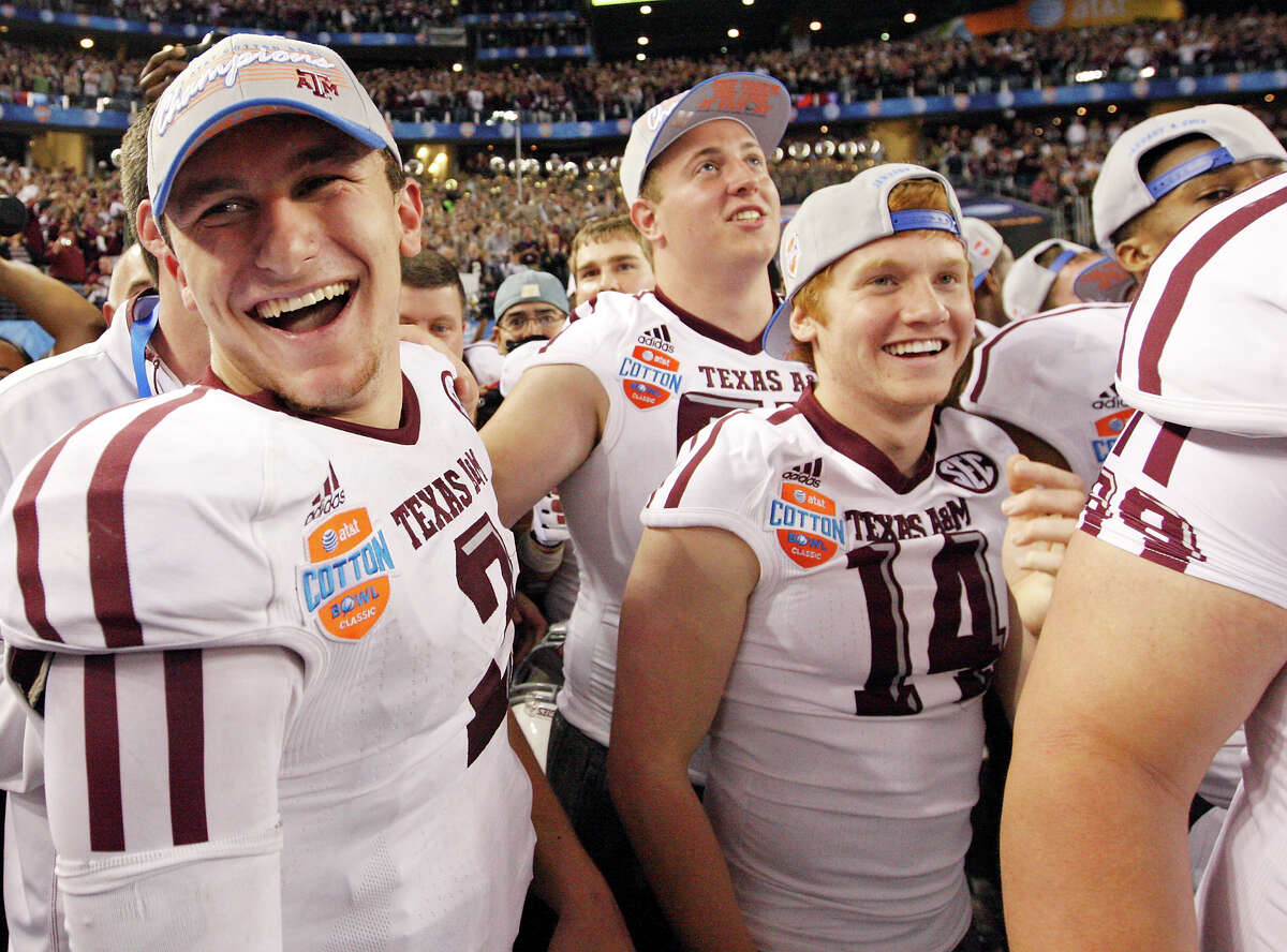 Texas A&M Aggies' Johnny Manziel (left) celebrates with teammates after the 77th AT&T Cotton Bowl Classic against the Oklahoma Sooners held Friday Jan. 4, 2013 at Cowboys Stadium in Arlington, Tx. The Aggies won 41-13.