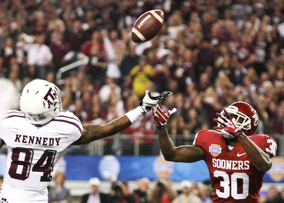 Oklahoma defensive back Javon Harris (30) intercepts a deflected ball intended for Texas A&M wide receiver Malcome Kennedy (84) during the second quarter of the Cotton Bowl college football game, Friday, Jan. 4, 2013, in Cowboys Stadium in Arlington. Photo: Nick De La Torre, Houston Chronicle / © 2013  Houston Chronicle