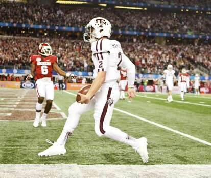 Texas A&M quarterback Johnny Manziel (2) scores a touchdown on the Aggies opening drive during the first quarter of the Cotton Bowl college football game against Oklahoma, Friday, Jan. 4, 2013, in Cowboys Stadium in Arlington. Photo: Nick De La Torre, Houston Chronicle / © 2013  Houston Chronicle