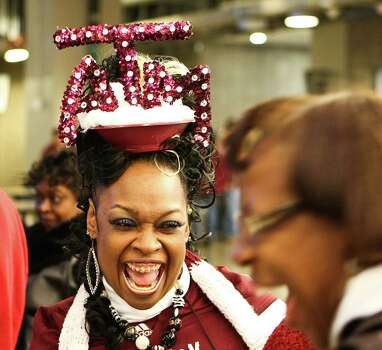 Rochelle Lutrall, of Rockport, Texas, laughs with friends before Texas A&M plays Oklahoma in the Cotton Bowl football game, Friday, Jan. 4, 2013, in Cowboys Stadium in Arlington. Photo: Nick De La Torre, Houston Chronicle / © 2013  Houston Chronicle