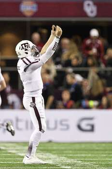 Texas A&M quarterback Johnny Manziel (2) celebrates after scoring a touchdown during the fourth quarter of the Cotton Bowl college football game against Oklahoma, Friday, Jan. 4, 2013, in Cowboys Stadium in Arlington. Texas A&M won 41-13. Photo: Nick De La Torre, Houston Chronicle / © 2013  Houston Chronicle