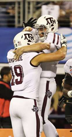Texas A&M tight end Michael Lamothe (19) celebrates after Texas A&M quarterback Johnny Manziel (2) scored a touchdown during the second quarter of the Cotton Bowl college football game, Friday, Jan. 4, 2013, in Cowboys Stadium in Arlington. Photo: Nick De La Torre, Houston Chronicle / © 2013  Houston Chronicle