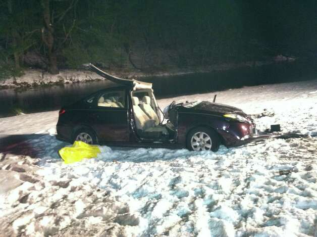 A serious two-car accident trapped one driver in her SUV in icy water late Friday night, according to Monroe fire officials. Another driver in a separate car was pinned against the wheel of his sedan, just feet from the water. Both drivers were rescued and taken to the hospital.  The accident occurred on Main Street near Knollwood Drive shortly after 11 p.m. Photo: Monroe Volunteer Fire Department