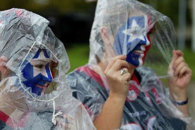 Houston Texans fans Brookelyn Mitchell, left, and Jen Schaefer walk outside Reliant Stadium on their way to the AFC Playoff game against the Cincinnati Bengals at Reliant Stadium on Saturday, Jan. 5, 2013, in Houston. Photo: Brett Coomer, Houston Chronicle / © 2013  Houston Chronicle
