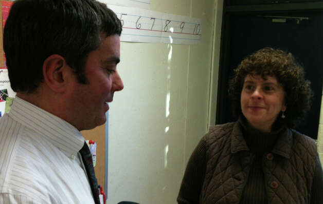 Fairfield Warde High School teacher James D'Acosta talks with Mary Ann Rooney, a fifth-grade teacher at Jennings School, after his students made presentations Friday on topics dealing with U.S. history between 1840 and 1890.  Fairfield CT 1/4/13 Photo: Andrew Brophy / Fairfield Citizen contributed