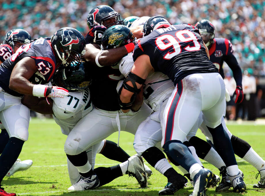 Sept. 16Texans 27, Jaguars 7 (2-0) The Texans bullied second-year quarterback Blaine Gabbert into submission, holding him to just seven completions and 53 yards passing while sacking him three times. The Jaguars' 117 total yards in what became a second consecutive 20-point victory were the fewest ever by a Texans opponent. Photo: Brett Coomer, Houston Chronicle / © 2012  Houston Chronicle