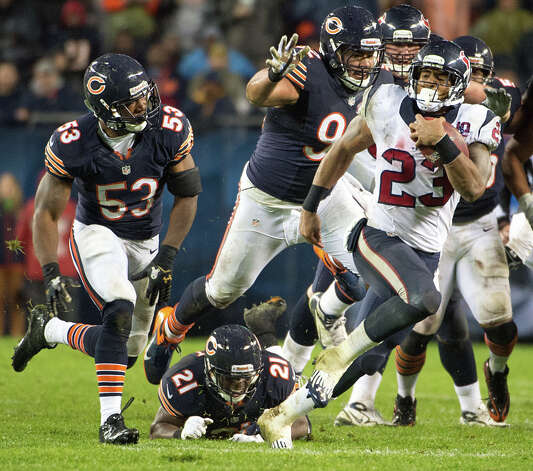 Nov. 11Texans 13, Bears 6 (8-1)On a rainy, windy night at Soldier Field, the Texans played ball control  with Foster rushing for 102 yards and delivered a Bears-worthy defensive effort that knocked Jay Cutler from the game with a concussion while keeping the Bears from crossing the goal line. Photo: Smiley N. Pool, Houston Chronicle / © 2012  Houston Chronicle
