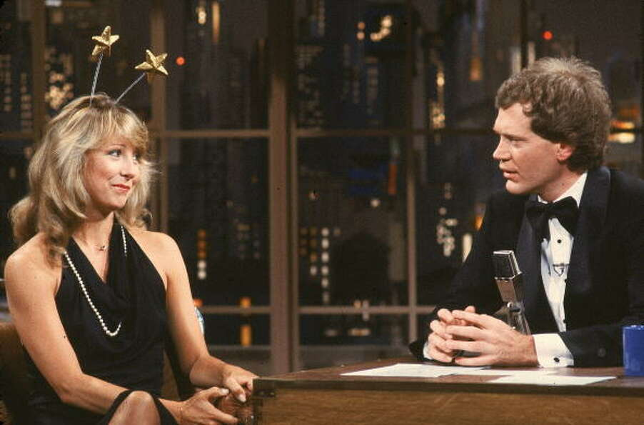 circa 1980s: American actress Teri Garr sits and talks with tuxedo-clad talk show host David Lett