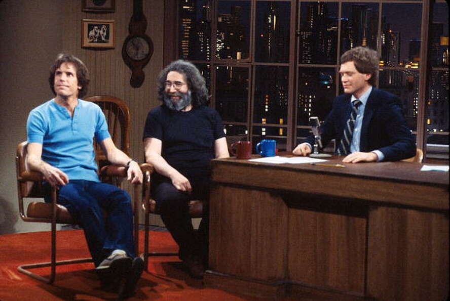 1982: (L-R) Musicians Bob Weir and Jerry Garcia with television talk show host David Letterman. G