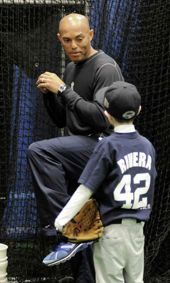 Yankees pitcher, Mariano Rivera, instructs Michael Pascento, 12, of New Milford during a clinic that was held Saturday Jan. 5, 2013 at Frozen Ropes in Danbury. Photo: Lisa Weir / The News-Times Freelance