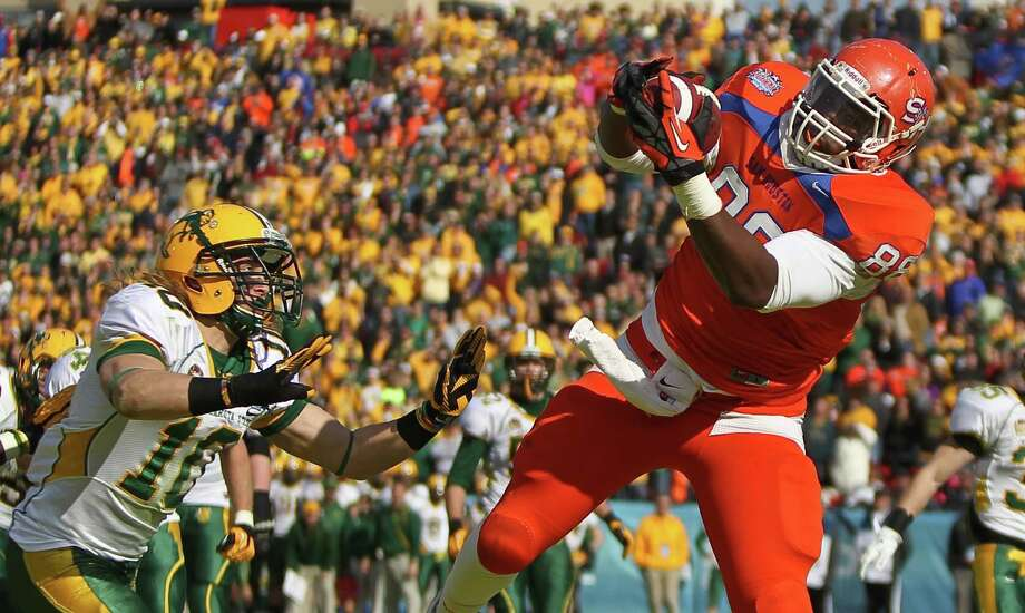 Sam Houston State tight end K.J. Williams (88) gets behind North Dakota State safety Bobby Ollman (10) for a touchdown catch during the second quarter of the NCAA Division One Football Championship, Saturday, Jan. 5, 2013, in Dallas FC Stadium in Frisco. Photo: Nick De La Torre, Houston Chronicle / © 2013  Houston Chronicle